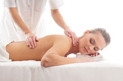 A young woman relaxing on a massage procedure Stock Photos