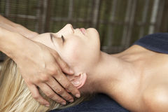 Young Woman Relaxing On Massage Table Stock Photo