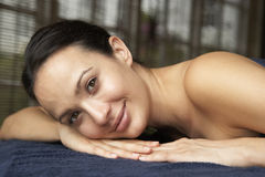 Young Woman Relaxing On Massage Table stock image