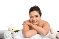 Young woman relaxing on massage table against white background. Spa procedures stock image