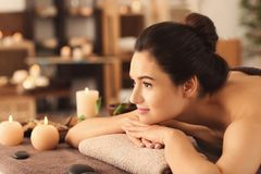 Young woman relaxing on massage table at spa salon royalty free stock photo