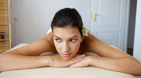 Young woman relaxing on massage table Royalty Free Stock Image