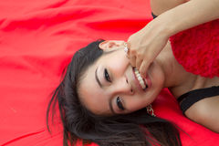 Young woman relaxing on mat Stock Images