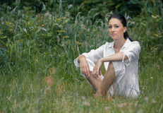 Young woman relaxing on meadow Stock Image