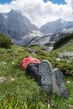 Young woman relaxing in a mountain meadow Royalty Free Stock Photo