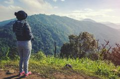 Young woman relaxing in natural park on the moutain stock image