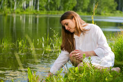 Young woman relaxing on nature Stock Photography