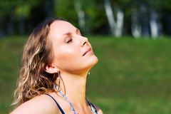 Young woman relaxing on nature Stock Images