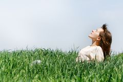 Young woman relaxing on nature Stock Photo
