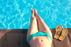 Young woman relaxing near swimming pool Stock Photography
