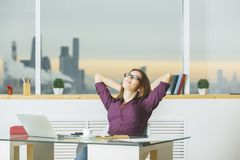 Young woman relaxing in office Stock Photos