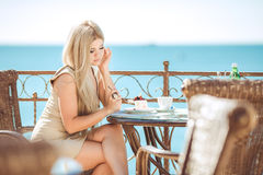 Young woman relaxing in an outdoor cafe Royalty Free Stock Image