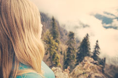 Young Woman relaxing outdoor on mountain summit with aerial view Stock Photography
