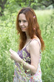 Young woman relaxing outdoor. Young pretty woman relaxing outdoor Stock Photos