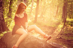 Young Woman relaxing outdoor in sunny forest Royalty Free Stock Images
