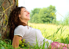Young Woman Relaxing outdoors Royalty Free Stock Images