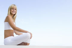 Young woman relaxing outdoors Stock Image