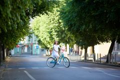 Cheerful woman cycling in the park. Young woman relaxing outdoors cycling in the park copyspace countryside road trip journey travelling tourism vehicle riding stock photo