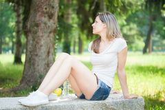 Young woman relaxing outdoors Royalty Free Stock Photo