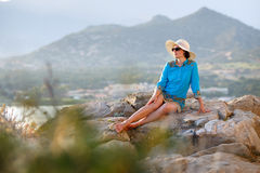 Young woman relaxing outdoors Stock Photography