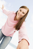 Young woman relaxing outside. Young woman relaxed and happy outside Royalty Free Stock Image