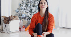 Young woman relaxing over the Christmas season Royalty Free Stock Image