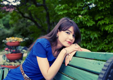 Young woman relaxing at park Stock Photos