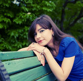 Young woman relaxing at park Stock Photo