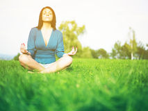 Young woman relaxing in park Royalty Free Stock Photos