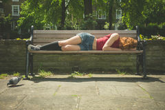 Young woman relaxing on park bench Royalty Free Stock Photo