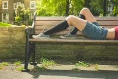 Young woman relaxing on park bench Royalty Free Stock Photography