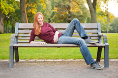 A Young Woman Relaxing in a Park Royalty Free Stock Photo