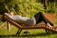 Young woman relaxing on the park. Stock Photos