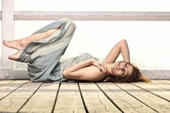Young woman is relaxing on the pier Royalty Free Stock Photo