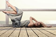 Young woman is relaxing on the pier Royalty Free Stock Images