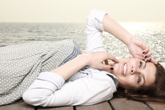 Young woman is relaxing on the pier Stock Images