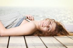 Young woman is relaxing on the pier Stock Photography