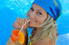 Young woman relaxing at the pool Royalty Free Stock Image