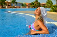 Young woman relaxing at the pool Stock Photos