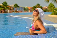 Young woman relaxing at the pool Royalty Free Stock Photography