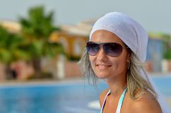 Young woman relaxing at the pool Stock Photography