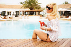Young woman relaxing at the pool Royalty Free Stock Photos