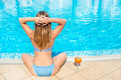 Young woman relaxing on the pool Royalty Free Stock Photos