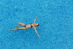 Young woman relaxing in the pool Stock Image