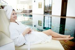 Young Woman Relaxing by Pool in SPA Stock Photos