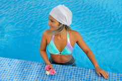 Young woman relaxing at the pool Stock Image