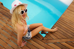 Young woman relaxing at the pool Royalty Free Stock Photo