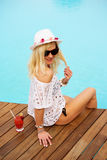 Young woman relaxing at the pool Royalty Free Stock Images