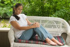 Young Woman Relaxing On Porch Stock Photos