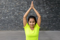 Young woman relaxing while practising yoga. Portrait of young woman relaxing while practising yoga pose, seated Mountain Royalty Free Stock Photography